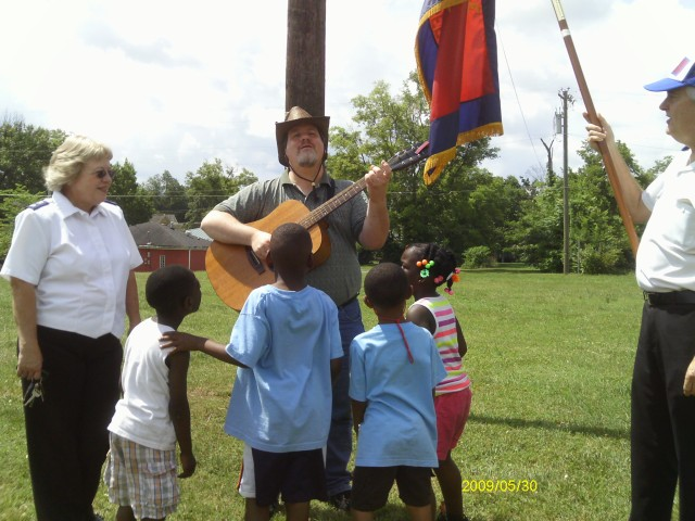 Singing prophetic songs to children in McFerrin Park.