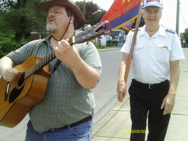 Singing a prophetic song over the McFerrin Park Neighborhood in East Nashville, Tennessee, USA, while prayer walking with The Salvation Army Flag